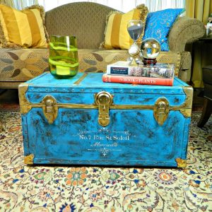 gold and blue painted storage trunk