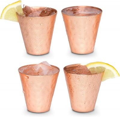 four copper shot glasses with lemon slices