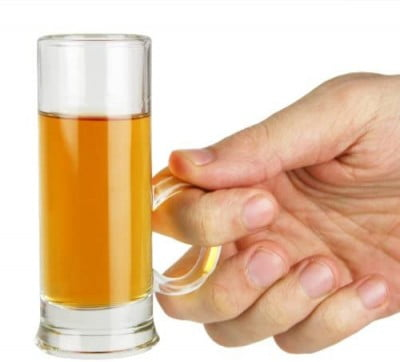 hand holding shot glass by handle